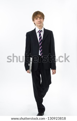 Office style showing by young teenage boy