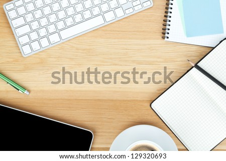 top office desks. office supplies gadgets and coffee cup on wooden table top desks