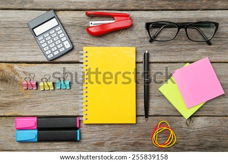 Office supplies on grey wooden background - stock photo