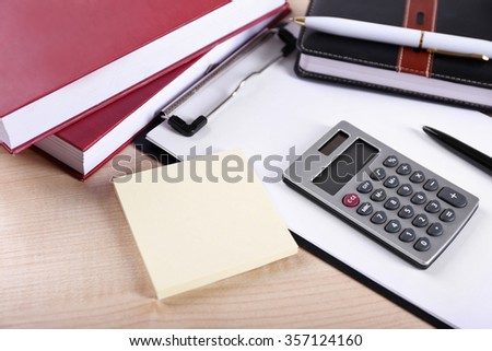 Office supply on wooden background