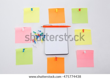 Office table, blank notepad and colorful pencil. View from above with copy space