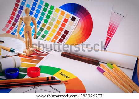 Office table desk with set of tools for creative art work on a white background.