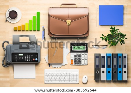 Office table with coffee cup, computer and flower. View from above - stock photo