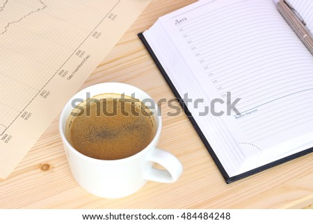 Office table with notebook book, coffee