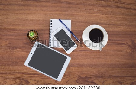 Office table with notepad, coffee cup , pencil,smartphone,tablet View from above with copy space