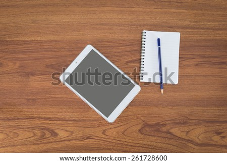 Office table with notepad, coffee cup , pencil, tablet View from above with copy space - stock photo