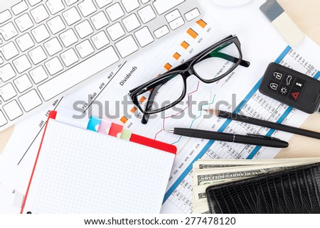 Office table with pc, supplies and money cash. View from above - stock photo