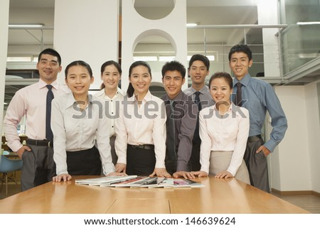 Office team standing near the desk, portrait - stock photo