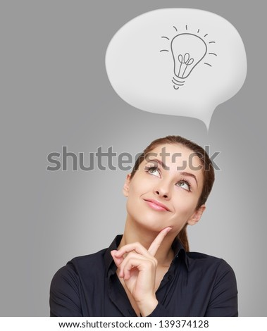 Office thinking woman looking up with idea sign in bubble on grey background - stock photo