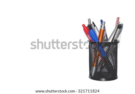 office tool - color pens in a black basket isolated on white background, copy space for text - stock photo