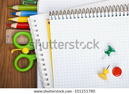 Office tools and notebook on the table