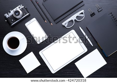 Office tools. Digital technology. Innovative implementation in business. Internet applications. Wireless function. Tablet phone and camera. Developing applications on the Internet. Flat lay photo - stock photo