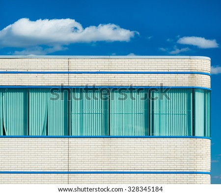 Office windows and blinds of a contemporary building - stock photo