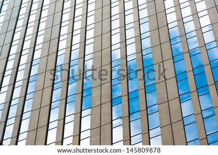 Office windows and blue sky refection. - stock photo