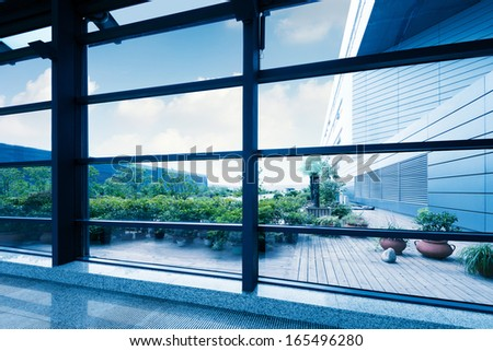 Office windows, modern building interior. - stock photo