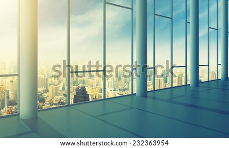 Office with glass wall and sunny weather - stock photo