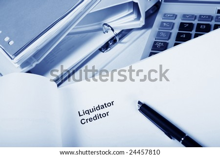 office with paper work headed liquidator creditor.
