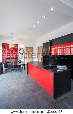 Office with red and black interior