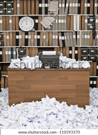 Office with vintage typewriter and a lots of papers - stock photo