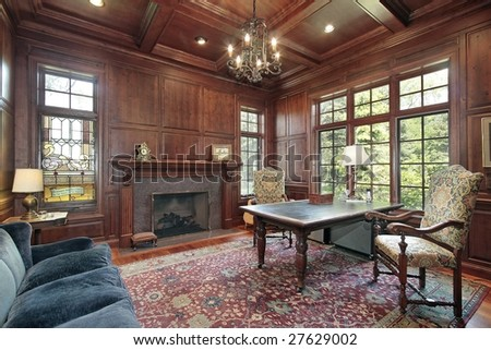 Office with wood paneling and fireplace - stock photo