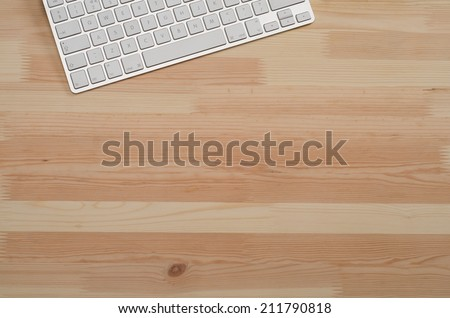 Office wooden desktop top down view with computer keyboard - stock photo