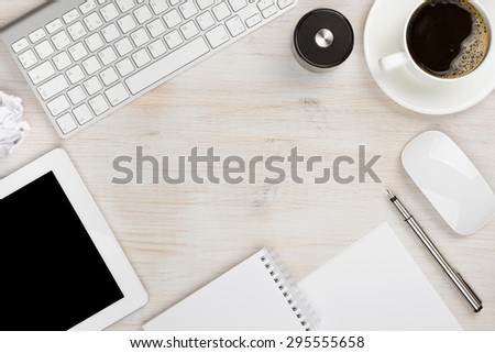 Office work essential tools with copy space in the middle - stock photo