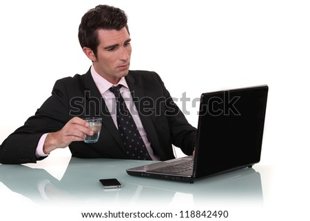Office worker drinking glass of water - stock photo
