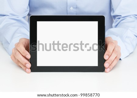 Office worker holding blank digital tablet with clipping path for the screen - stock photo