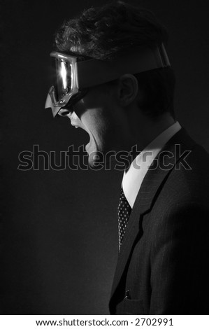 Office worker in goggle  in a rage. Half face. Black&white