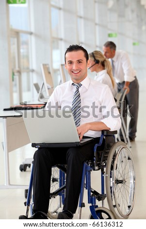 Office worker in wheelchair - stock photo