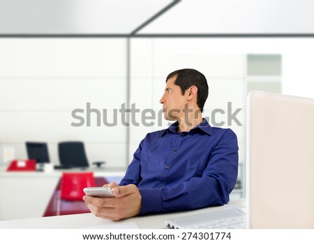 office worker sending a message with the phone hidden social networks - stock photo