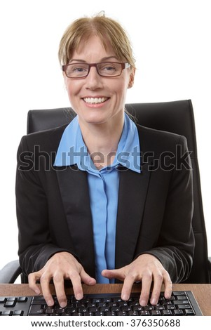 Office worker sits at her desk, ready to type on a keyboard, isoalted on white
