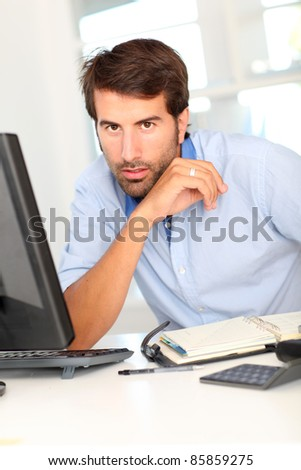 Office worker sitting at his desk