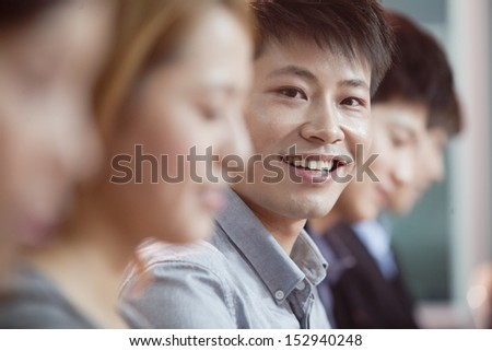 Office Worker Smiling and Looking at Camera - stock photo