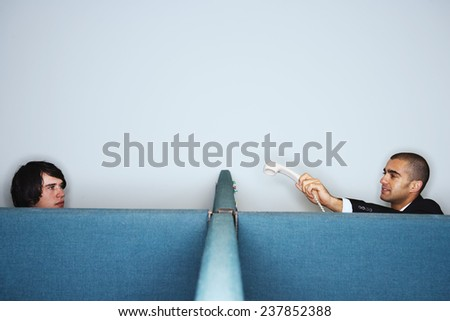 Office Worker Transfering Phone Call - stock photo