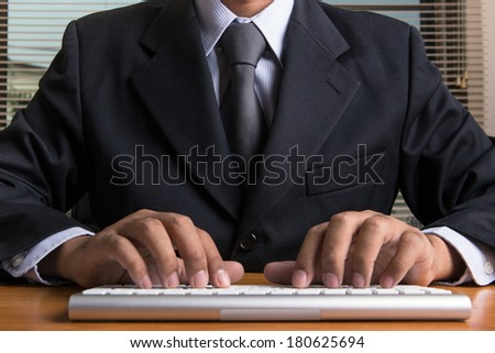Office worker typing on the keyboard - stock photo
