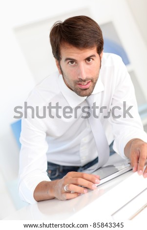 Office worker using electronic tablet