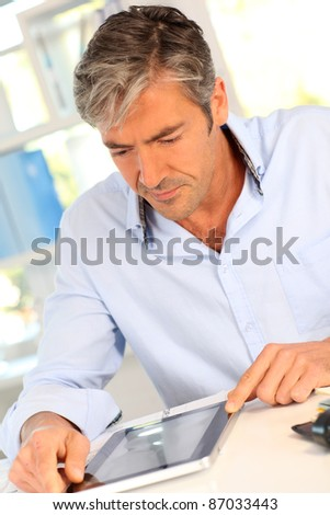 Office worker using electronic tablet - stock photo