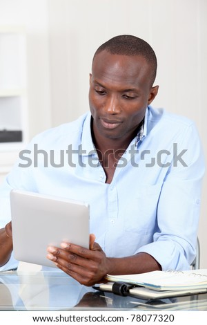 Office worker using electronic tablet at work