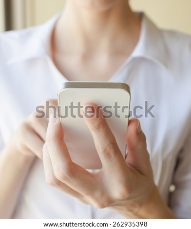 Office worker using smartphone - stock photo