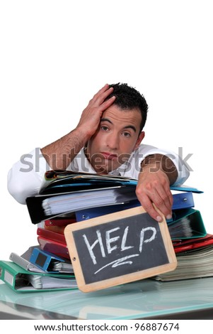 Office worker with a sign asking for help - stock photo
