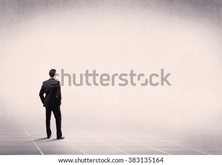 Office worker with briefcase standing with his back facing an empty space with filtered color concept - stock photo