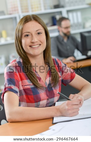 Office worker writing in her diary