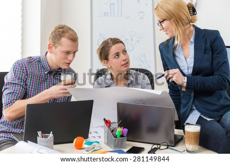 Office workers talking about guidelines to project - stock photo