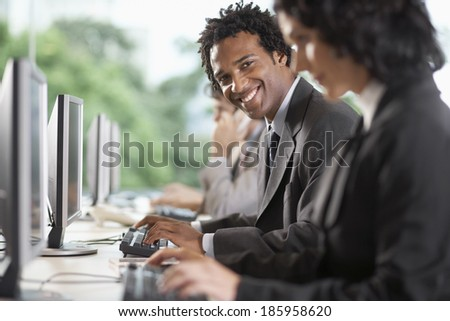 Office workers using computers - stock photo