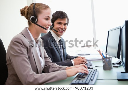 Office workers using computers in an office - stock photo