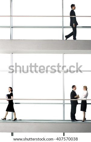 Office workers walking around modern office building - stock photo