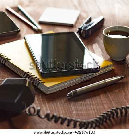 Office workplace/ Tablet PC, notebook and folder on the office desk, a cup of tea or a cup of coffee. View from above with copy space. Free space for text. Workplace