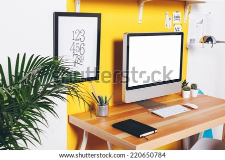 Office workplace with computer./ Modern creative workspace on yellow wall.  - stock photo