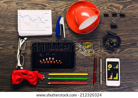 Office workplace with tablet cup mobile phone and stationary - stock photo